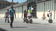 People riding segway Stock Footage