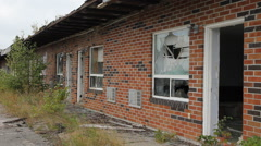 Wrecked, bankrupt motel with broken window and no door. Stock Footage
