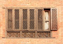Old wooden traditional nepalese window detail. Stock Photos