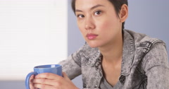 Tough Chinese woman looking at camera - stock footage