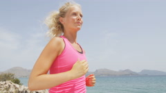 Running woman runner  jogging exercising outside on beach Stock Footage