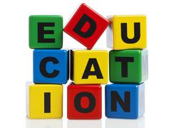 Education spelled with stacked alphabet building blocks Stock Photos