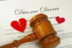 broken red hearts and legal gavel on divorce papers - stock photo