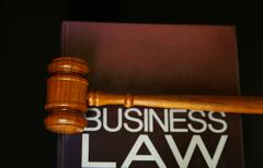 Judges gavel on a business law book Stock Photos
