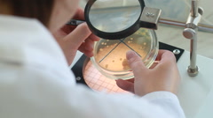 Male scientist working in with microscope Stock Footage