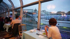 People enjoy dinner in a cruise liner restaurant along the moscow river trip. Stock Footage