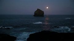 Moon light shining, pyramid rock at dawn, Atlantic ocean, Reykjanes, Iceland Stock Footage