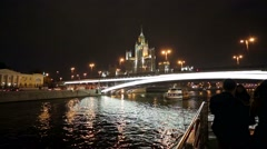 Tourists enjoy boat ride by Moscow river at night. Stock Footage