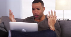 Black guy streaming the game on his laptop Stock Footage