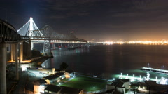 4k time lapse of the new span of the San Francisco Bay Bridge at night Stock Footage