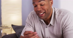 Black man webcamming with mother on smartphone Stock Footage