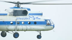 Mil Mi-8 helicopter hovering in the air Stock Footage