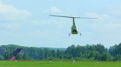 Helicopter performing aerobatics, celebration of Aviator's day airshow Stock Footage