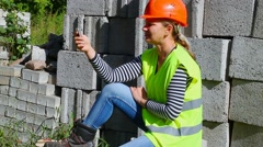 Woman-builder with the cell phone Stock Footage