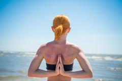 Stock Photo of Woman doing yoga reverse namaste