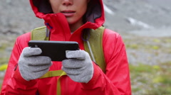 Smart phone woman texting sms using app on smartphone with touchscreen gloves Stock Footage