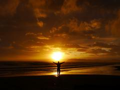 man ocean sunset arms wide open - stock photo
