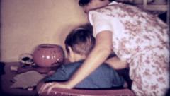 1220 - mom helps daughter with school homework - vintage film home movie Stock Footage