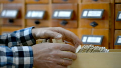 Reader searching in the card index - stock footage