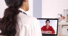 Mexican doctor advising patient via webcam Stock Footage