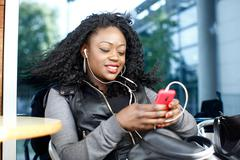 black female listening music from phone play list - stock photo