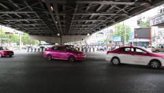 Road traffic under bridge in Bangkok, Thailand Stock Footage