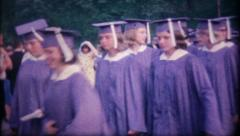 1228 - graduating class in cap & gown - vintage film home movie - stock footage