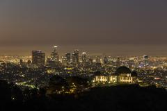 griffith observatory and downtown los angeles before dawn - stock photo