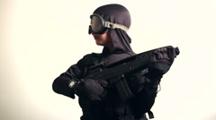 Child with tactical gear and goggles looking left and right - stock footage