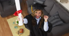 Female graduate celebrating with diploma - stock footage