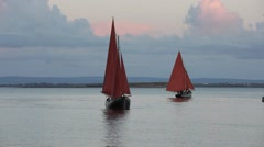 Boats with red sail Stock Footage