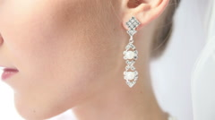 bride earring with pearls - stock footage
