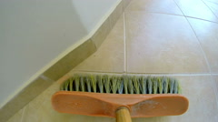 4k broom sweeping pov 2 dustpan. sweeping a hardwood floor from the perspecti Stock Footage