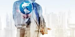 Double exposure of business engineer holding the earth and abstract city as c Stock Illustration