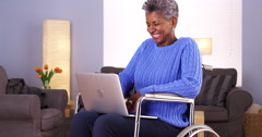 Mature African woman talking with friend on laptop Stock Footage