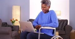 Mature Black woman talking with friend on laptop Stock Footage