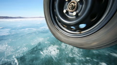 Drive the car across the frozen lake baikal Stock Footage