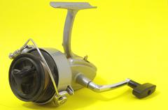 Vintage old fishing reel Stock Photos