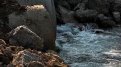 Water running through concrete tube Stock Footage