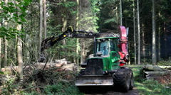 Heavy forestry equipment called a wood chipper Stock Footage