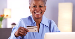 Happy Mature Black woman holding credit card - stock footage