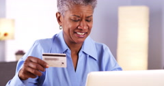 Happy Mature African woman buying things online - stock footage