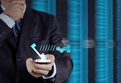 Businessman hand using the phone tablet touch computer gadget as concept Stock Illustration