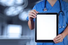 Doctor working with tablet computer with operating room Stock Illustration