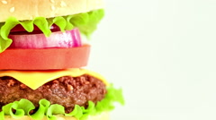 Tasty and appetizing hamburger cheeseburger Stock Footage