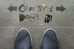 hand drawn creative design word on front of business man feet as concept - stock illustration