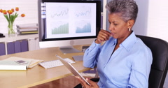 Senior african manager working at desk with tablet Stock Footage