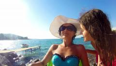 4k crane shoot of mother and daughter in emotional hug on summer beach Stock Footage