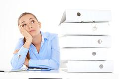 Bored female employee on white background - stock photo