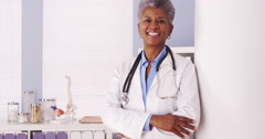 Happy African Senior doctor standing in office - stock footage